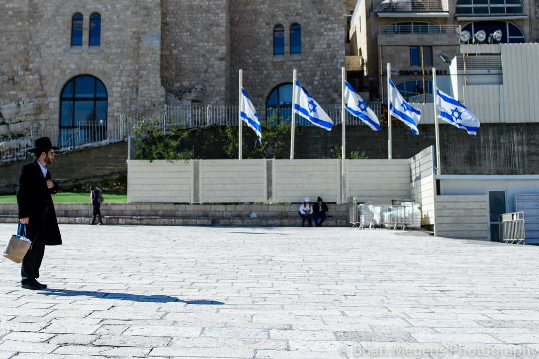 A Jewish man on his way to the Wailing Wall.