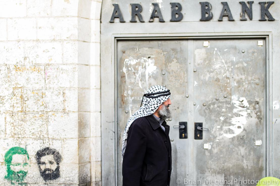 A man wearing the Kufiya on the streets of Ramallah.